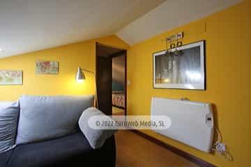 Bajo cubierta: salón. Vivienda vacacional Villa Ruiz